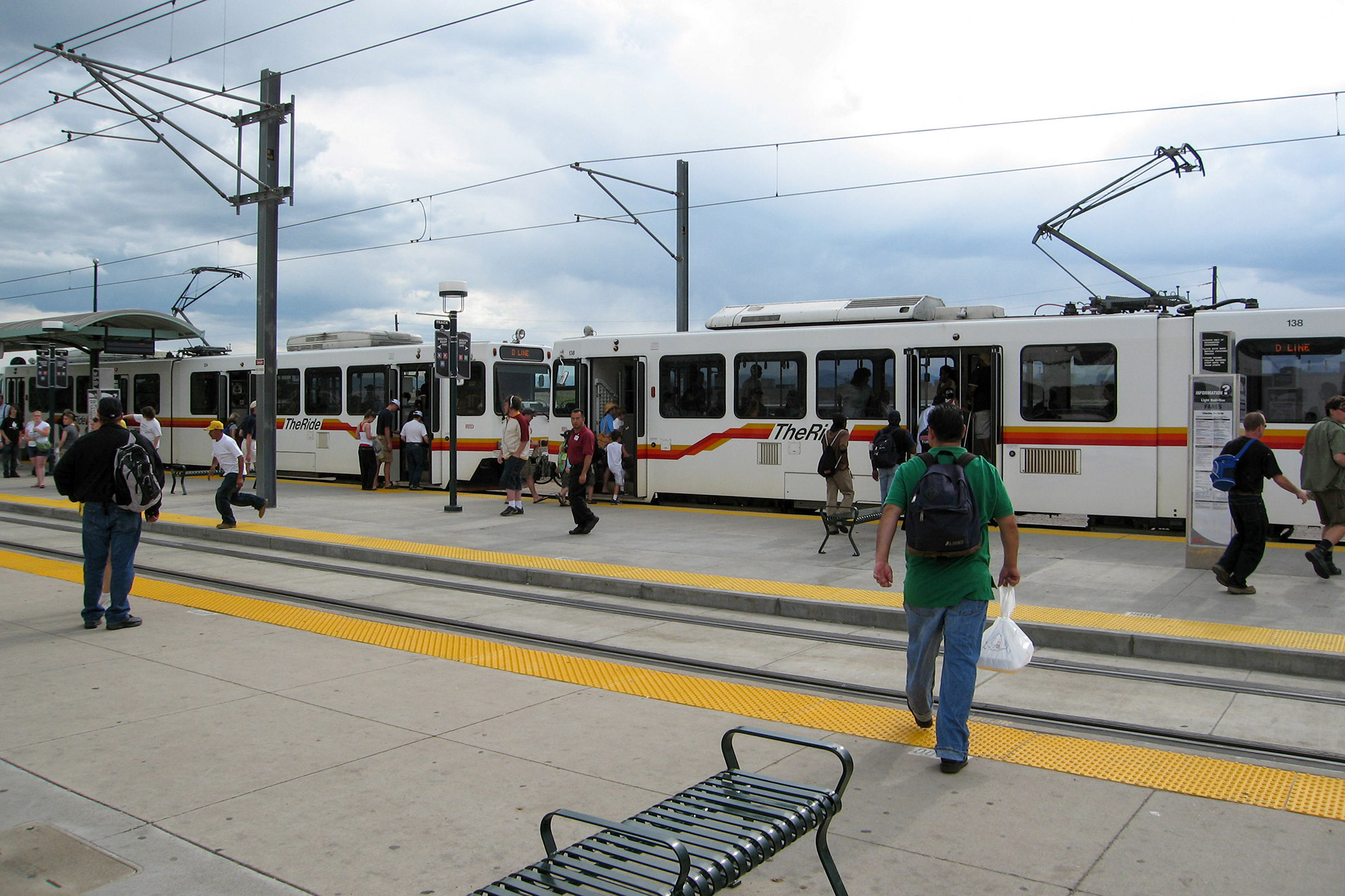 Transit users at Denver's Broadway station. Image courtesy of Wikimedia Commons (By Mobyll)