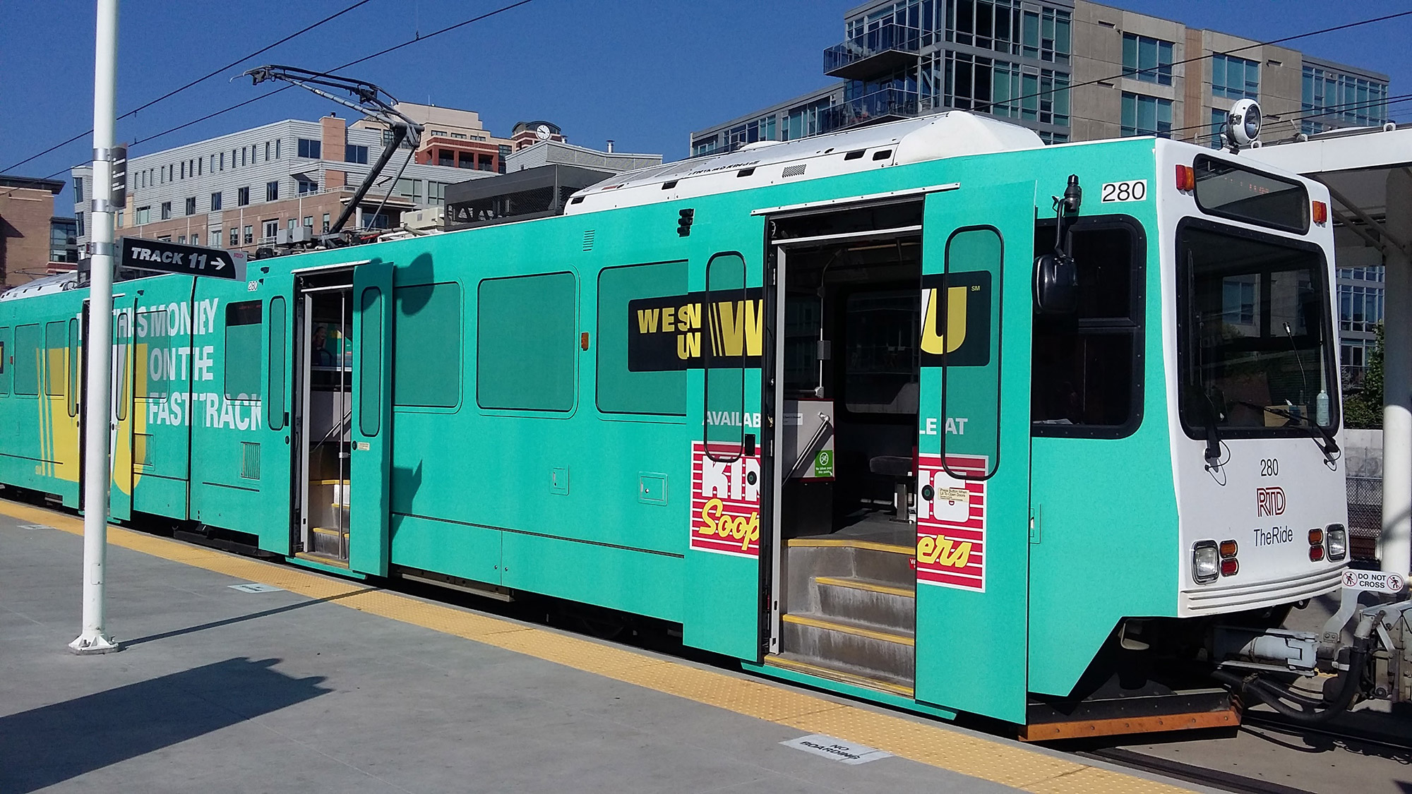 RTD light rail train covered in ads. Image courtesy of Wikimedia Commons (By Xnatedawgx)